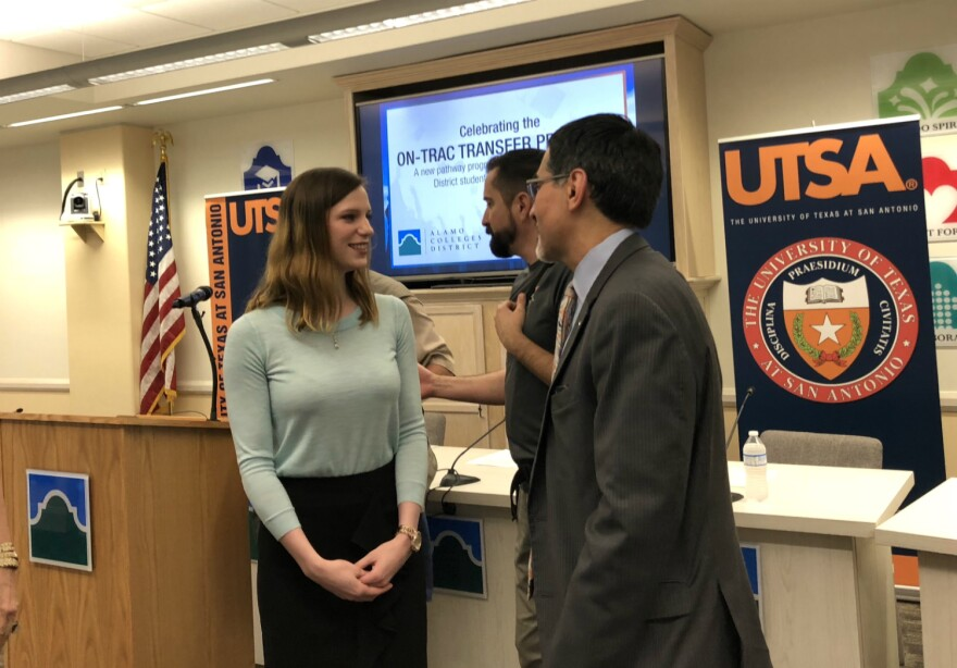 UTSA junior Karen Elliot speaks with Mike Flores, who will become the next chancellor of the Alamo Colleges District in the fall during a news conference announcing the On-TRAC program Feb. 20, 2018.