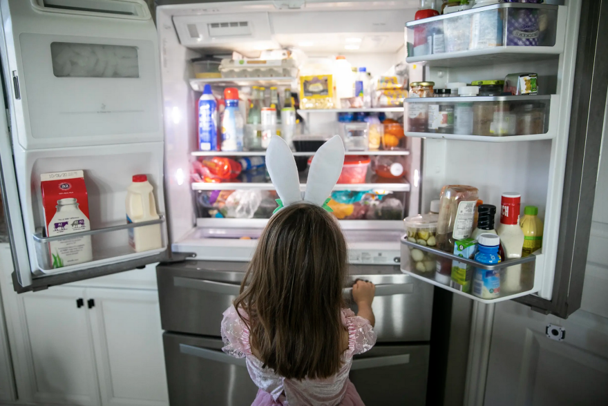 Five-year-old Nora checks out the snack situation during a break in virtual learning in her home in Katy.