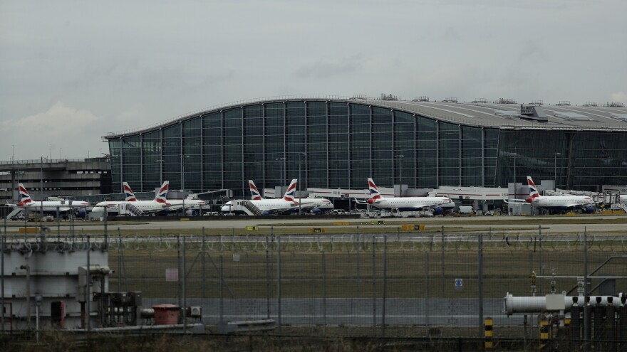British Airways planes sit parked at London's Heathrow Airport on Monday. British Airways says it has had to cancel almost all flights as a result of pilots' 48-hour strike over pay.