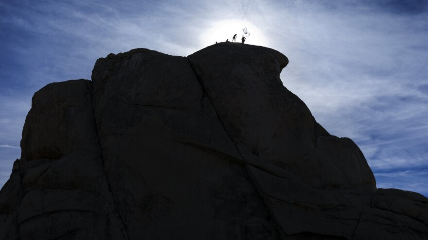 Rock climbers can get into Joshua Tree National Park in California, but they cannot access its visitors center or other facilities because of the government shutdown.