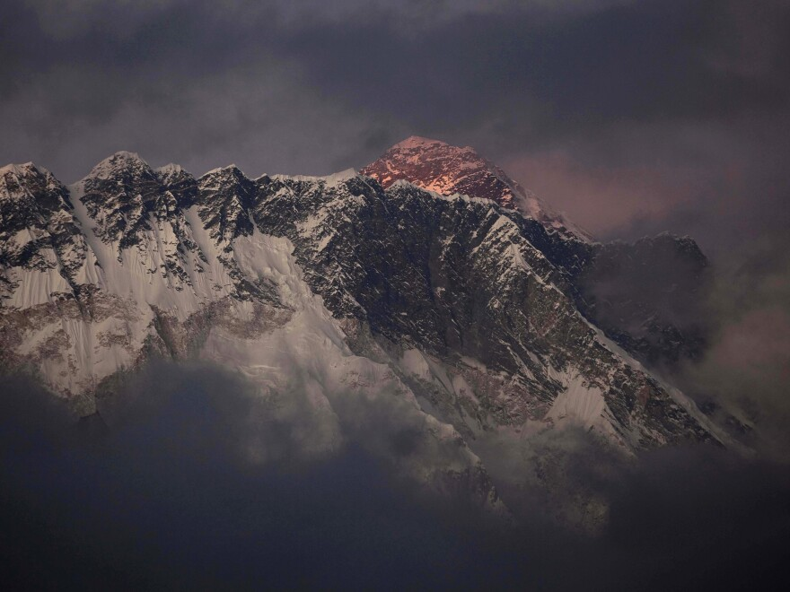 The sun shines on the peak of Mount Everest in this October 2011 photo. On Friday, an avalanche killed at least 12 Sherpas on the mountain.