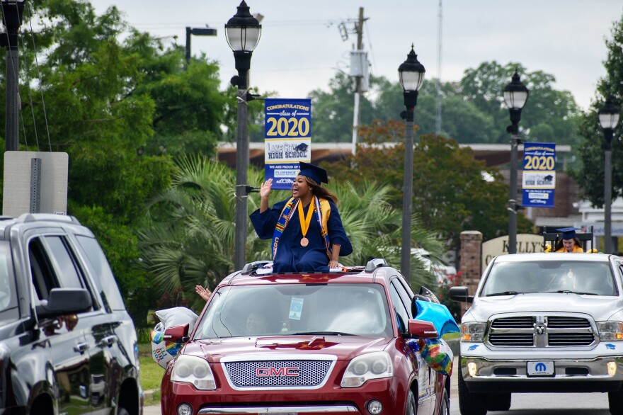 Valedictorian Kimani Ross leads the Lake City High School parade through downtown Lake City, SC.