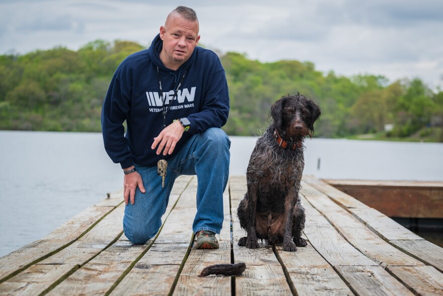 Army veteran Lynn Rolf III, and Boomer, his dog. Rolf was diagnosed with post-traumatic stress disorder after serving in Iraq.