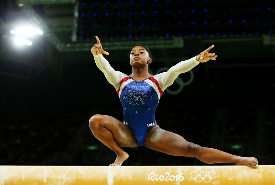 Simone Biles of the United States competes on the balance beam during the women's individual all-around gymnastics final on Thursday. Biles won the gold and teammate Aly Raisman took the silver.