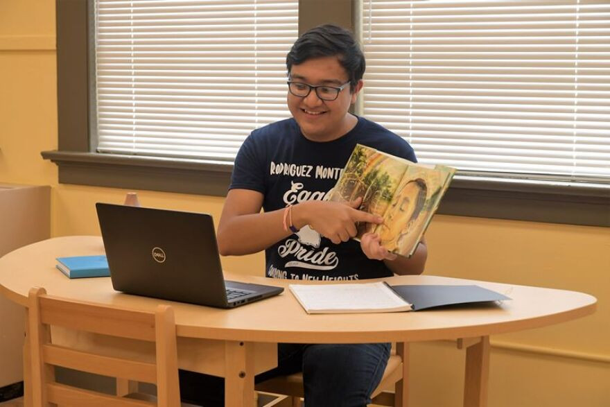 Bilingual guide Oliver Ramirez reads a book at Rodriguez Montessori Elementary to students learning remotely on the first day of SAISD's 2020-2021 school year.