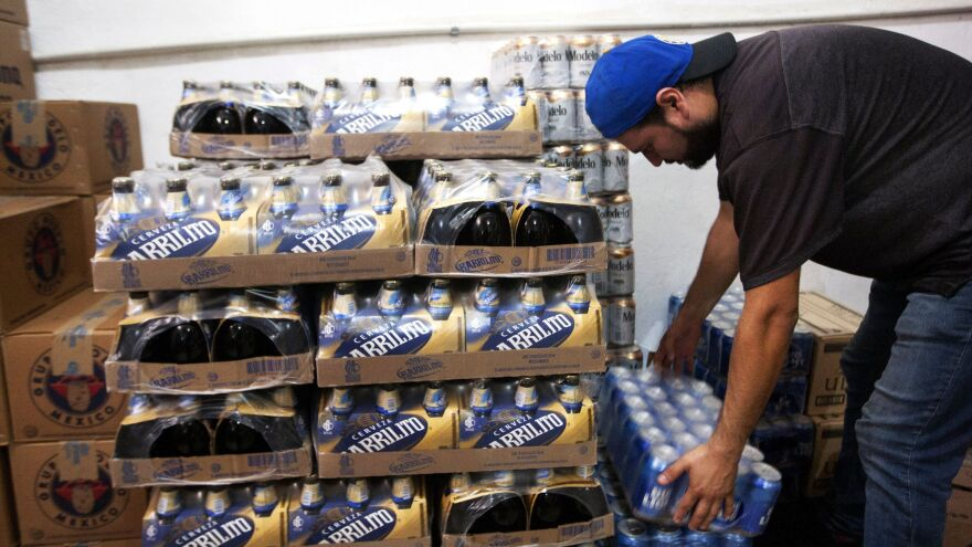 A man stores beer in a shop in Monterrey, Nuevo Leon state on Friday.