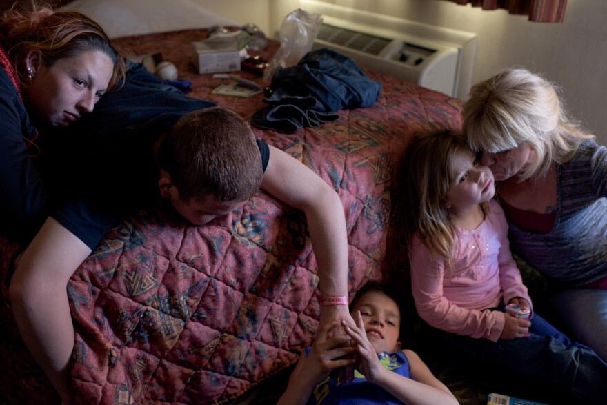 """Vinny, now 16, and his girlfriend (left) visit his younger siblings and mom. """"I feel happy when I'm with my mom, little siblings and my older brother. I make the best of what I have,"""" says Vinny."""