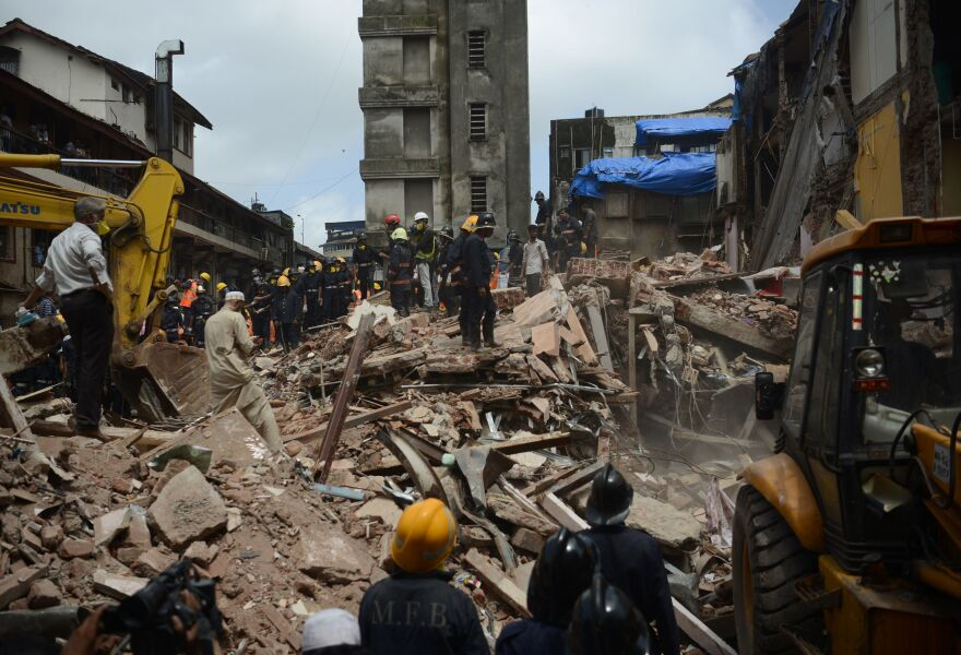 Rescue workers look for survivors in the debris of a collapsed building in Mumbai, India, on Thursday.