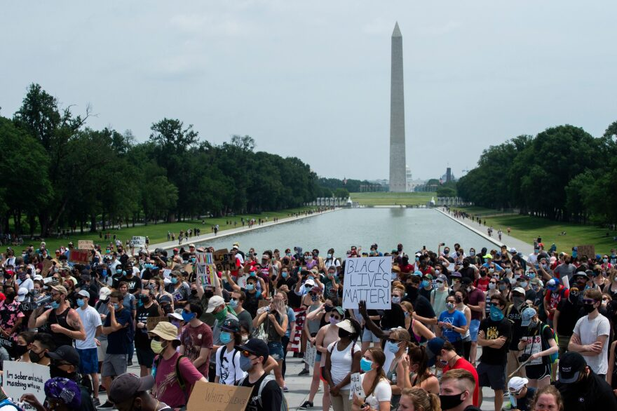 Demonstrators protest at Lincoln Memorial near the Washington Monument (rear) during a protest against police brutality and racism, on June 6, 2020 in Washington, DC. (ROBERTO SCHMIDT/AFP via Getty Images)