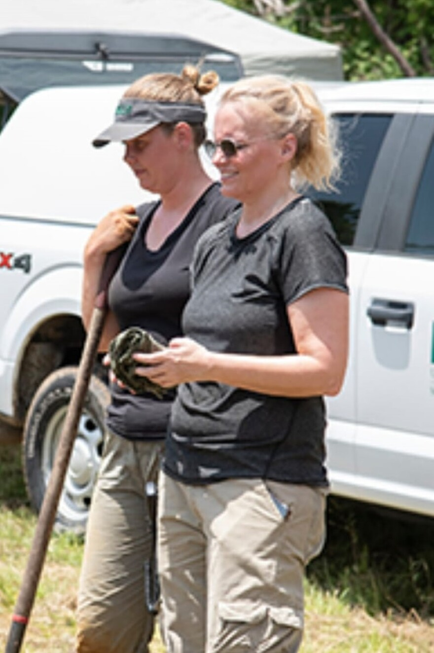 USF forensic anthropologist Erin Kimmerle, right, supervises work at the site of the Dozier School for Boys in Marianna in June.