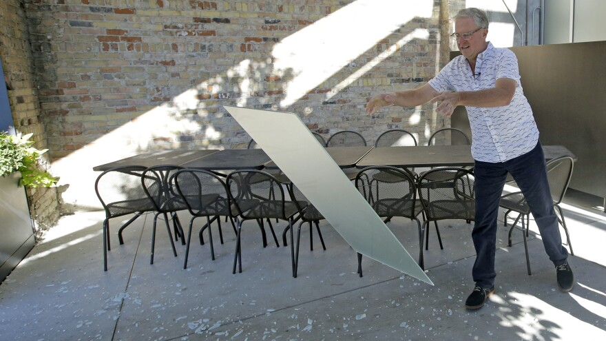 """Utah restaurant owner Joel LaSalle smashes a partition known as a """"Zion Curtain"""" that prevented customers from seeing alcoholic drinks being mixed and poured. On Saturday, a new rule allowed some restaurants to tear down this wall."""
