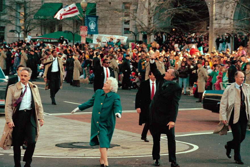 President George H.W. Bush and his wife, first lady Barbara Bush, acknowledge the crowd on Pennsylvania Avenue after getting out of their limousine and walking the inaugural parade route in Washington, D.C.. Earlier, Bush was sworn in as the 41st president of the United States.