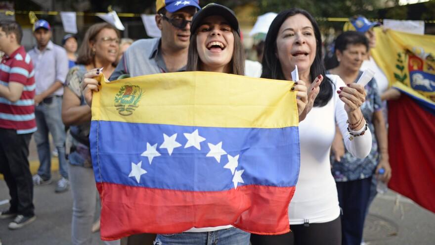 Activists celebrate Sunday in Caracas after voting in an opposition-organized referendum on President Nicolas Maduro's plan to rewrite Venezuela's Constitution.