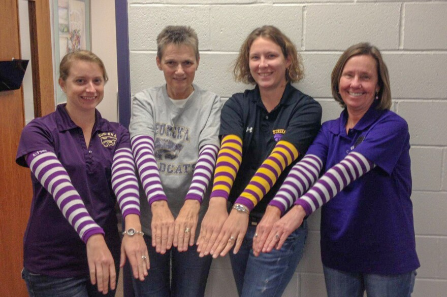 Sandy Kearney, second from left, with Eureka High School co-workers in an October 2014 photo.