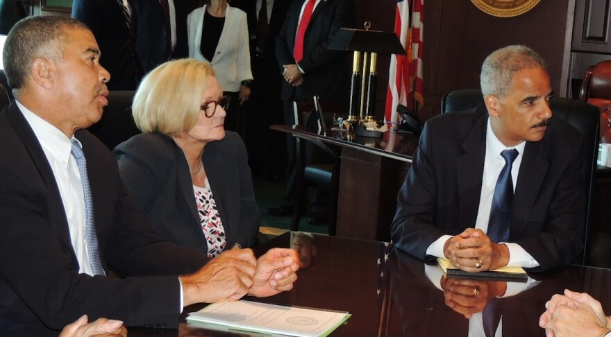 U.S. Rep. Lacy Clay, D-St. Louis, left, U.S. Sen. Claire McCaskill, D-Mo., and Attorney General Eric Holder met on Wednesday to talk about the killing of Michael Brown.