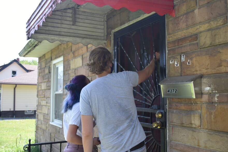 DSA members knock at a home where eviction may occur cr. Conor Morris.JPG