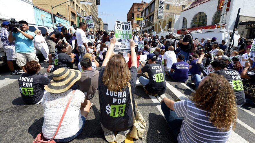 Protesters assemble in front of a McDonald's in Los Angeles, demanding a $15 an hour minimum wage in September.