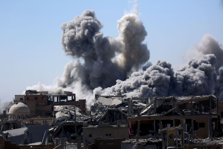 Smoke billows in Raqqa on Sept. 3, 2017, as Syrian Democratic Forces, a U.S. backed Kurdish-Arab alliance, battle to retake the city from the Islamic State group.