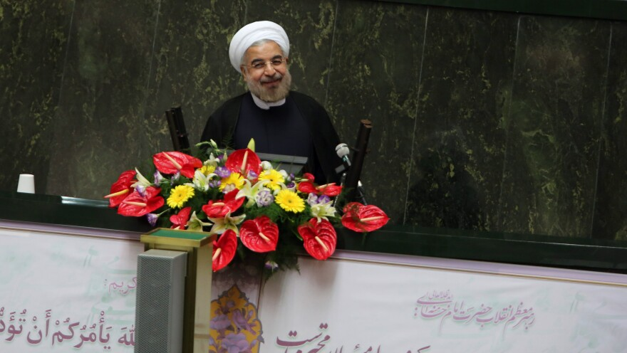 Iran's President Hasan Rowhani, who was elected in June, has exchanged lettes with President Obama, the U.S. leader said in an interview that aired Sunday. Here, Rowhani speaks to Iran's Parliament in Tehran.