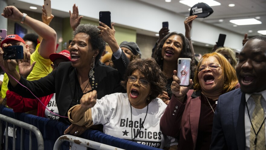 Supporters cheer as the president arrives to speak during the launch of Black Voices for Trump in November in Atlanta.