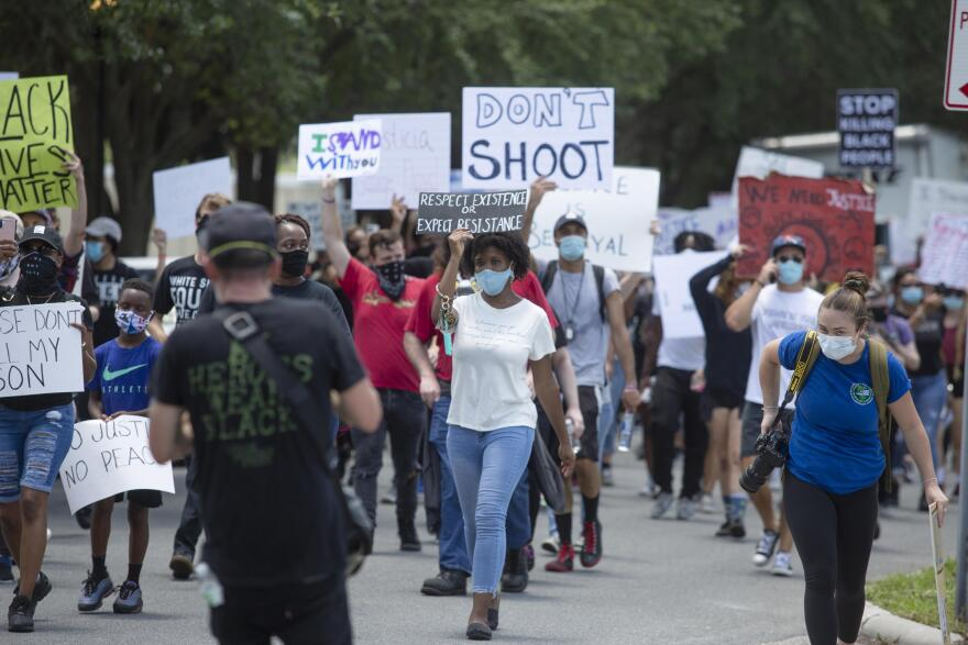 Protesters march in Tampa
