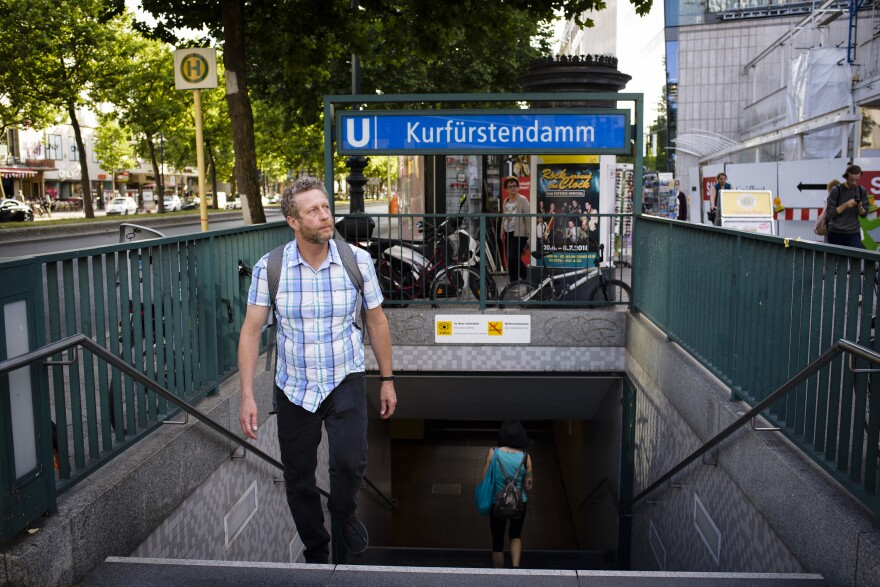 Uri Berliner emerges from the Berlin subway. He came to the city to research his father's and his grandparents' lives, and to finally see his dad's toy monkey for himself.