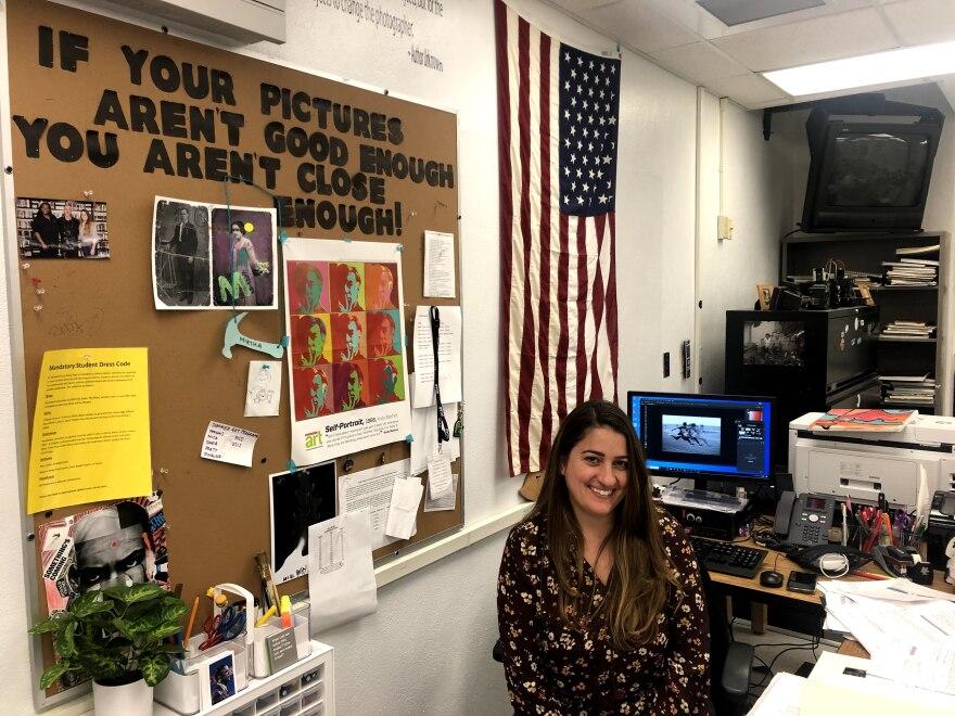 Krop teacher Mirtha Funcia at desk.jpg