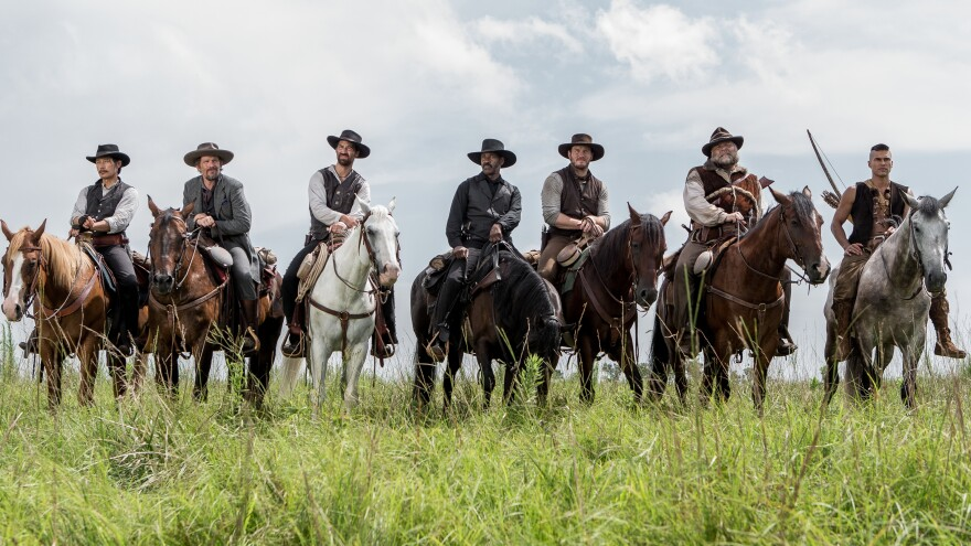 A group of seven bounty hunters, gamblers and hired guns (played by Byung-hun Lee, Ethan Hawke, Manuel Garcia-Rulfo, Denzel Washington, Chris Pratt, Vincent D'Onofrio and Martin Sensmeier) band together to protect a village in Antoine Fuqua's remake of <em>The Magnificent Seven. </em>