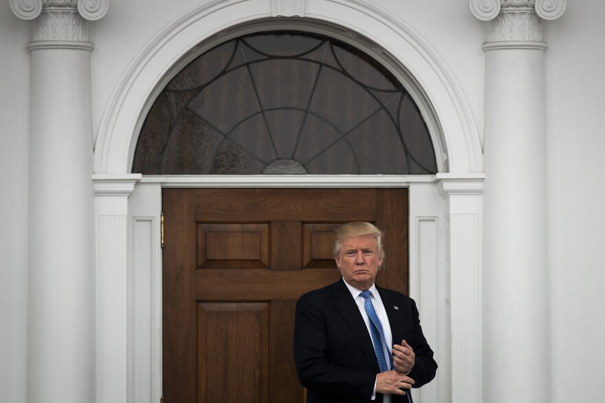 President-elect Donald Trump stands outside the clubhouse following his meeting with Peter Kirsanow, an attorney and member of the U.S. Commission on Civil Rights, at Trump International Golf Club, Sunday in Bedminster, N.J.