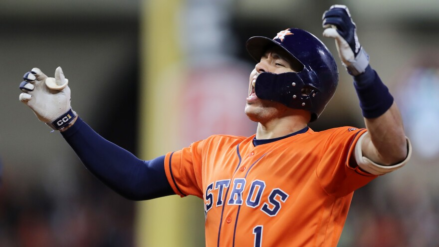 Carlos Correa celebrates after hitting an RBI single for the Houston Astros against the Washington Nationals during the fifth inning of Game 7.
