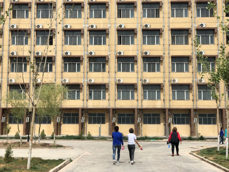 In Kashgar, students walk toward a dormitory on the campus of a detention facility for Uighurs and other Muslim minorities.