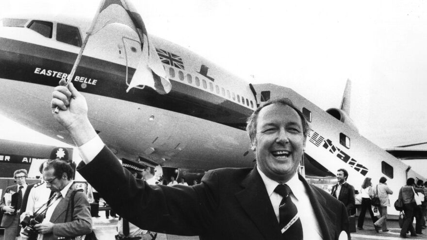 "British entrepreneur Freddie Laker waves a flag in front of a Douglas DC-10 in 1977 at the launch of his no-frills ""Skytrain"" service. The DC-10 had already experienced multiple catastrophes as a result of design flaws, and another deadly crash came two years later."