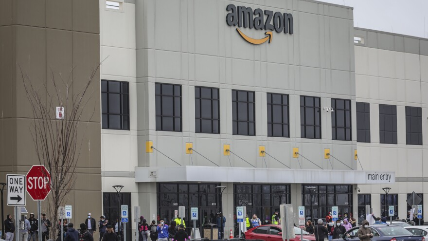Workers at Amazon's fulfillment center in Staten Island, N.Y., gather outside to protest work conditions on March 30. More protests are being staged around the country this week.