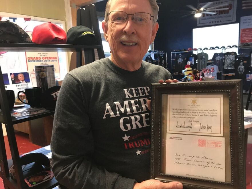 Trumped Store and Coffee House co-owner Steve Slaton shows off a letter signed by President Trump.