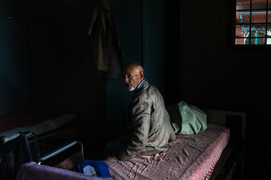 A resident of the senior home in his room after lunch.