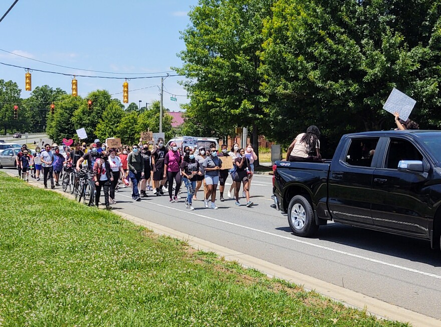 About 60 young people marched against racial injustice in south Charlotte Friday. (David Boraks/WFAE)