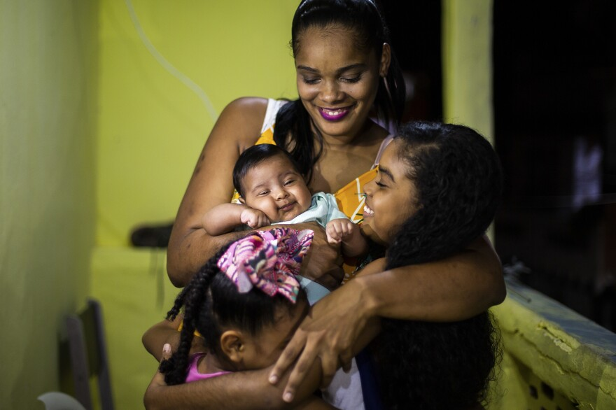 "Renan Benedito photographed Marluce dos Santos Sousa, 32, and Davi, now 2 months old. During her pregnancy, she said, ""I felt immersed in a sea of uncertainty"" because of COVID-19 and her mother's death. Her son ""brought joy. I know Davi will find a different world. It will no longer be necessary for the pandemic to show us the value of being together."" <em>July 1. Salvador, </em><em>Brazil.</em>"