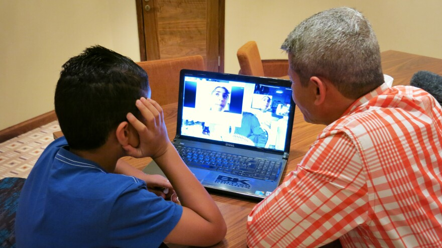 Palestinian Imad Abudayyah and his son, Ghassan, speak to relatives in the Gaza Strip via Skype from Ramallah in the West Bank. Israeli restrictions make it extremely difficult to travel between the two territories. West Bank Palestinians have largely been bystanders in the current round of fighting.