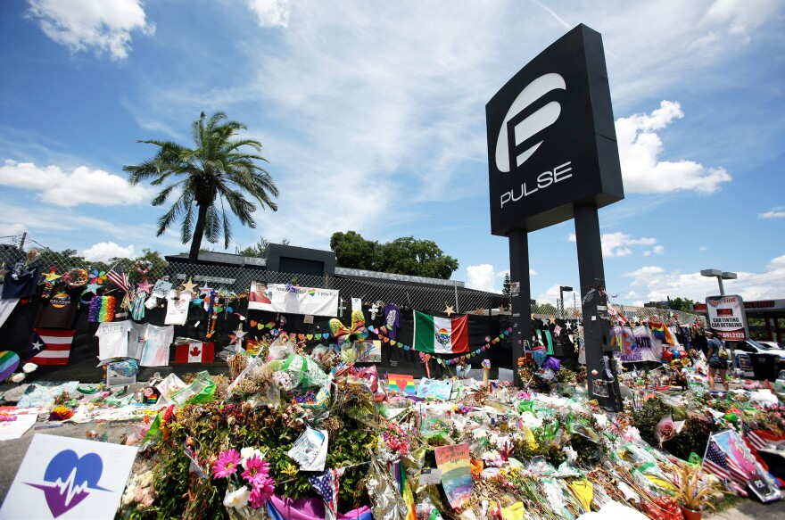 A makeshift memorial continues to grow outside the Pulse nightclub in Orlando, Fla., on July 11, one month after the mass shooting at the club.
