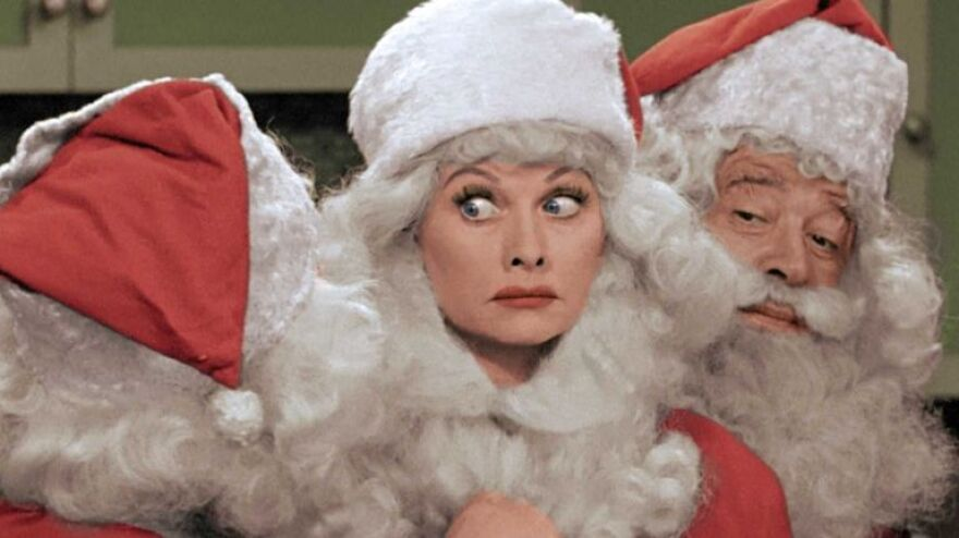 A photo of Lucy dressed as Santa Claus from the I Love Lucy Christmas episode.
