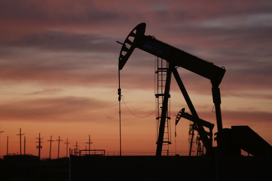 An oil pumpjack works at dawn Jan. 20 in the oil town of Andrews, Texas.