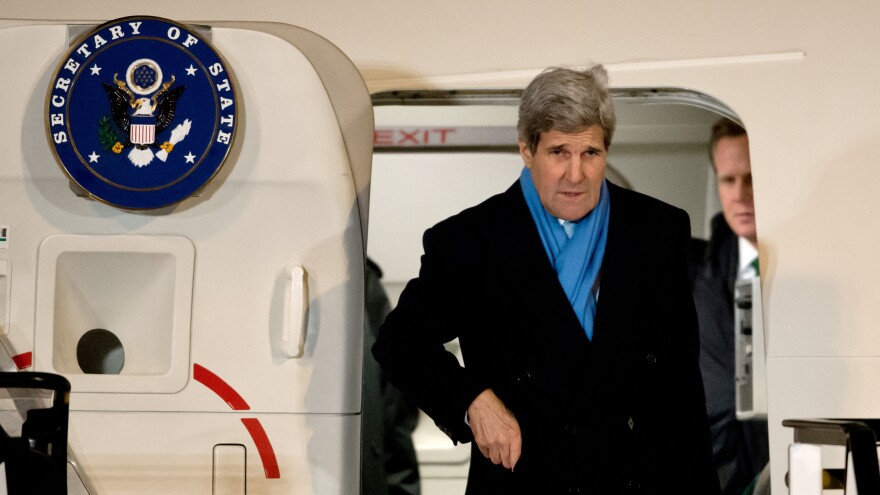 Secretary of State John Kerry arrives at the airport in Munich, Germany, on Feb. 5. On the way back to the U.S., Kerry's plane stopped in Boston during a snowstorm so he could see his new grandchild. Such personal stops are permitted, though they sometimes raise eyebrows.