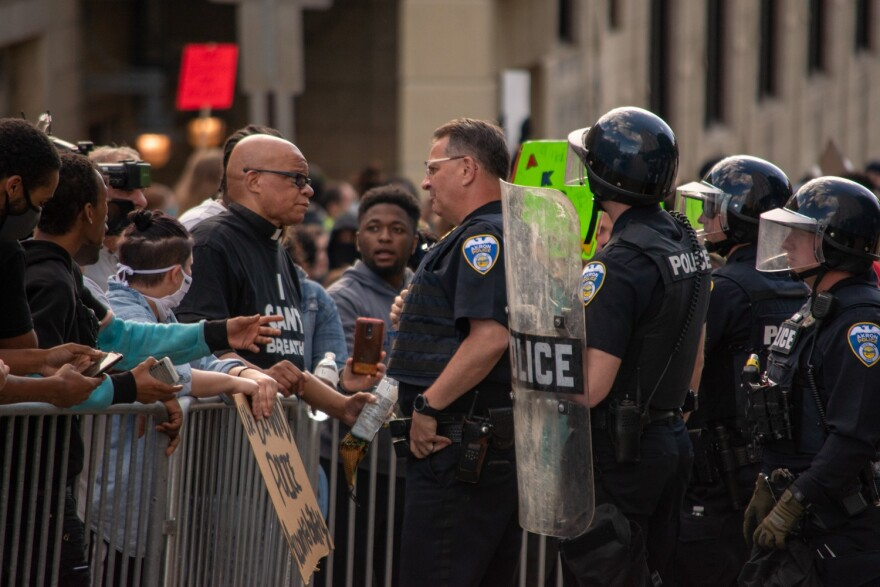 a photo of protester talking to police