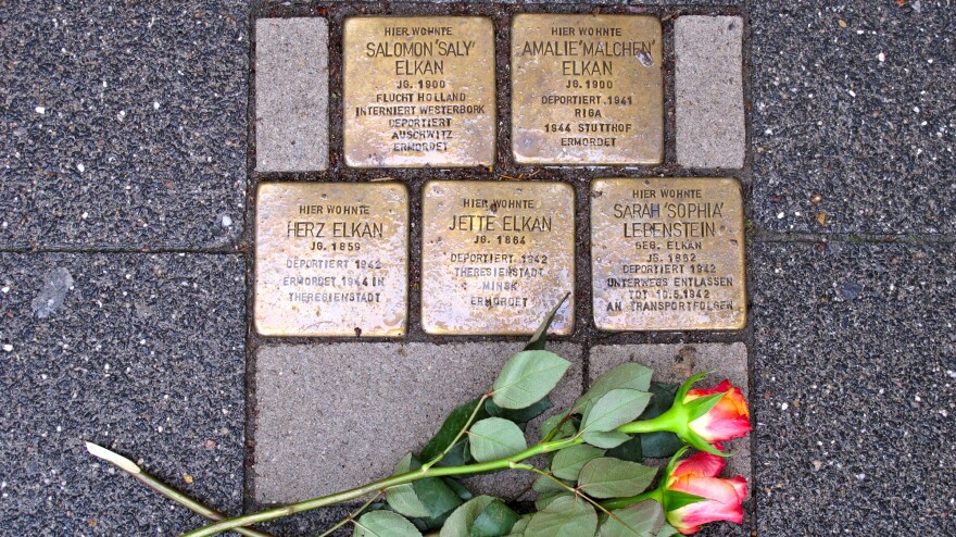 """Brass bricks known as <em>Stolperstein,</em> or """"stumbling stones,"""" in front of a home in Raesfeld, Germany, where five members of a single family were forcibly removed by the Nazis. Across Germany, the stones commemorate the millions of victims of the Nazi regime."""