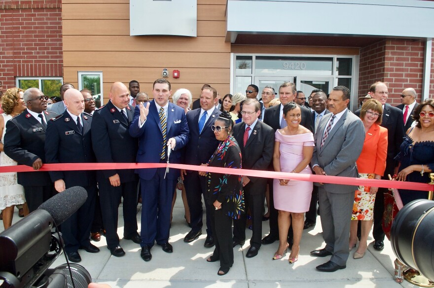Leaders prepare to cut the ribbon in front of the Ferguson Community Empowerment Center on Wednesday, July 26, 2017. It's on the site of the QuikTrip that was burned during protests following Michael Brown's fatal shooting.