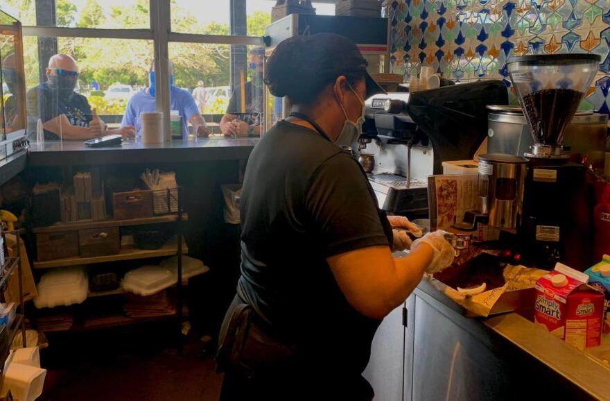 Marlene Oviedo brewing coffee at the Sergio's ventanita in Doral.