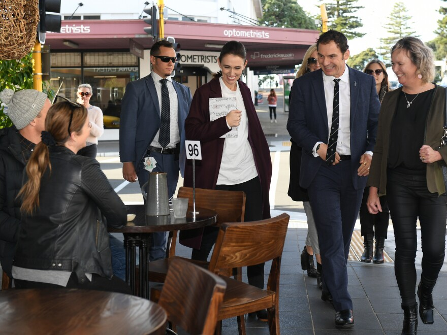 New Zealand is now allowing gatherings of up to 100 people, and the country says it has just one active COVID-19 case. Much of the credit for the country's success has gone to Prime Minister Jacinda Ardern, seen here walking through the coastal city of Napier on Friday.