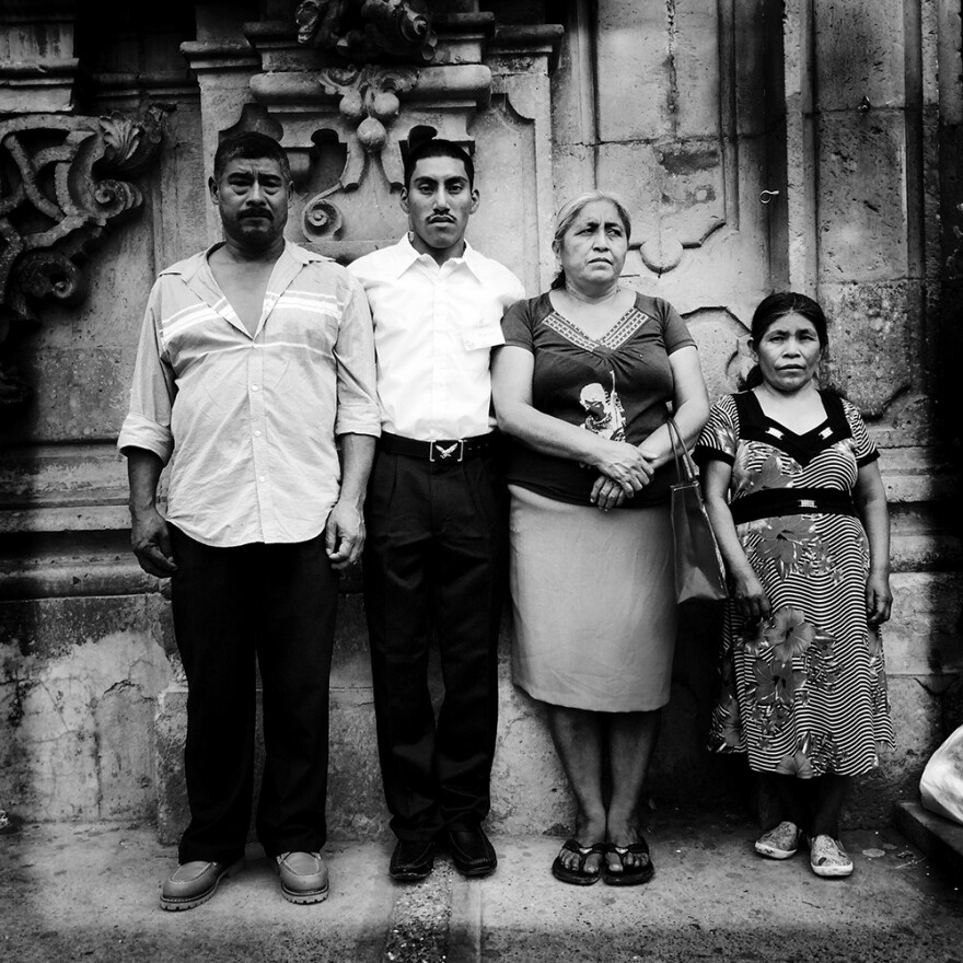 """""""Family Portrait After Church."""" Don Bernabe, left, and Dona Delfina, third from left, are the parents of missing Mexican student Adan Abrajan de la Cruz. They're posing with their godson, Marcos, and his mother, Dona Rosa. <em> </em>"""