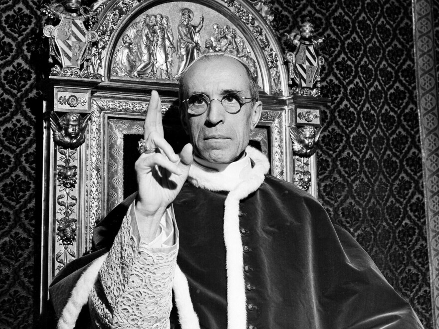 In this file photo dated September 1945, Pope Pius XII raises his right hand in a papal blessing at the Vatican. Pope Francis opened the Vatican archives on Pope Pius XII in March.