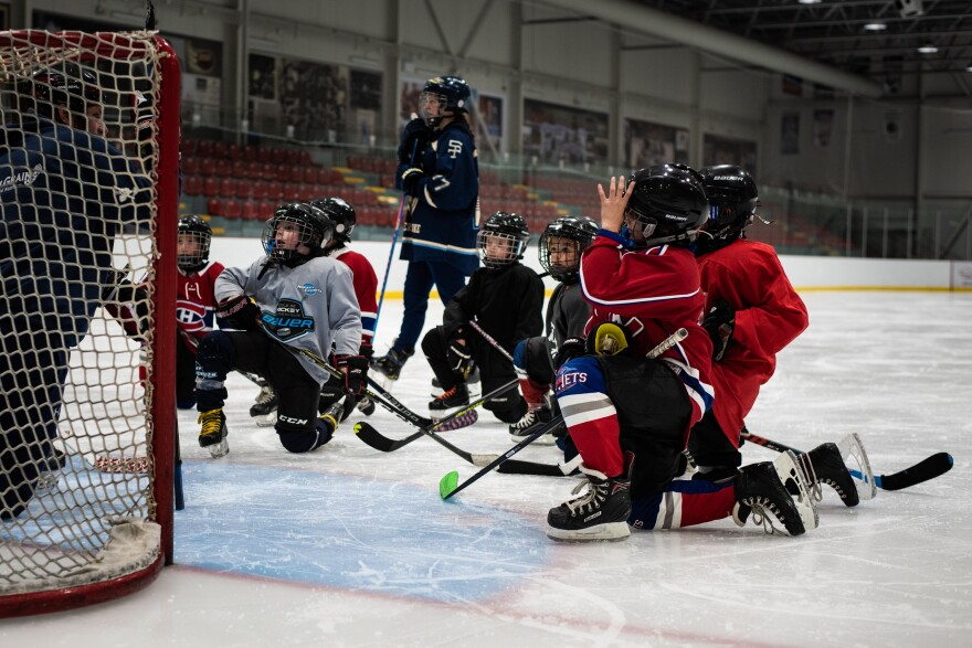 The Border Jets, a novice hockey team, practice at the Pat Burns Arena in Stanstead, Quebec. The team is made up of both Canadian and American players.
